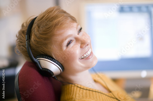 Smiling woman on headphones