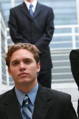 Three business people on steps