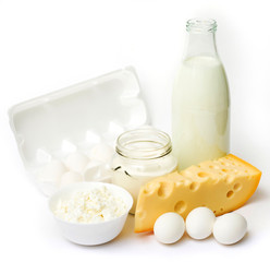 Fresh eggs and dairy products in glass containers