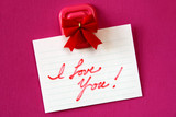 Red I love you note on magenta background.. poster