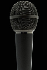 a microphone against dark background