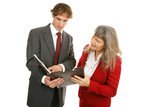 Young male employee showing his female boss the report.   poster