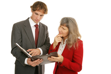Young businessman and  female boss going over a report