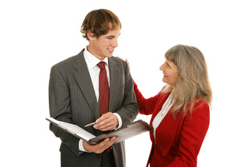 Mature female boss congratulating her young male employee