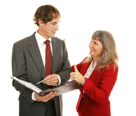 Female boss congratulating her young male employee