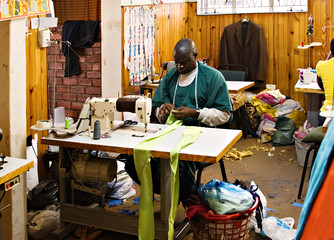 African American man working in a tailor workshop