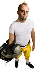 An American football player. Standing holding shoulderpads.