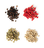 Heaps of assorted peppercorns on white background, top view poster