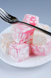 Turkish delight (lokum) confection on a white dessert plate poster