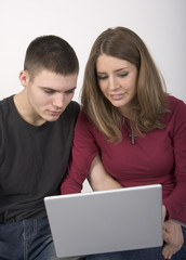 Young couple looking at a laptop computer together