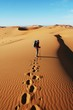 Man go up in sand desert