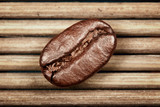 Fototapety coffee bean on the mat background.