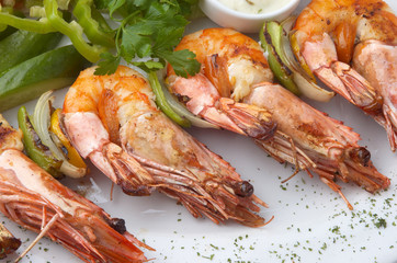 large grilled shrimps, selective focus