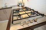 Integrated gas hob in a modern kitchen poster