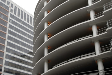 Curved concrete parking structure & generic office building