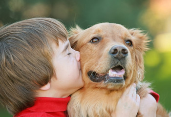 Boy Kissing Dog