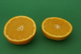 Two halves/ pieces of an orange. Fruit. Nutrition. Healthy food poster