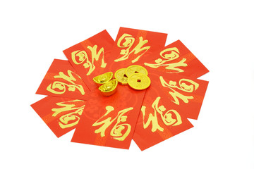 Chinese red packets and ornaments of gold ingots and coins