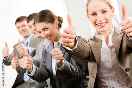 Successful business people showing a sing of okay