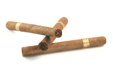 three large cuban cigars isolated on white background
