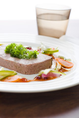 Gourmet game Pâté with vegetables and jam on the table