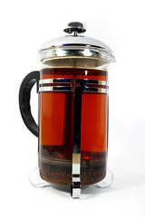 transparent kettle whith hot black tea