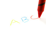 Red crayon writing abc, isolated on white poster