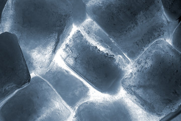 close up of ice cubes lit by back light