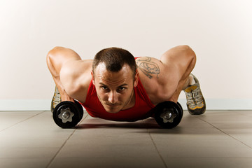 Push up with dumbbells, classic endurance exercise