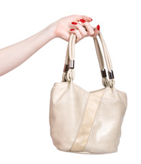 Woman hand with handbag. Isolated on white.