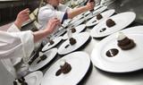 chefs preparing chocolate pastries in kitchen poster