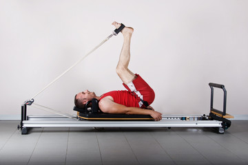 The L position with cords. Pilates gymnastics