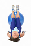 Woman lying down with a gym ball