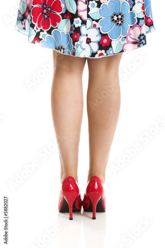 Beautiful picture of female legs with red shoes