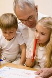 Grandpa is teaching his grandchildren to write   poster