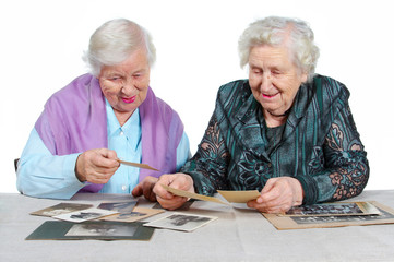 Two grandmothers with old photos.
