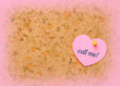 Cork board with heart shape sticky note. Call me inscription