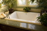 Luxurious bathtub with plants and other decor. poster