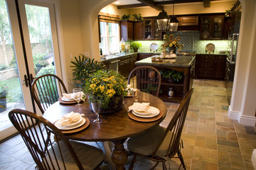 Kitchen with breakfast table and modern decor.