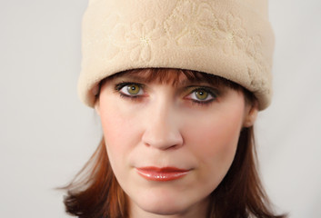 woman with beige hat