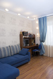 cozy, comfortable room with sofa, writing-table and window poster