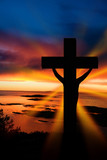 Fototapety A cross at sundown on the ocean