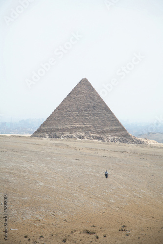 two men walking towards micerinos pyramid in el cairo