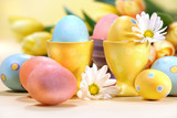 Colorful Easter eggs with flowers on the counter poster