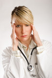 young beautiful woman doctor in stress portrait poster