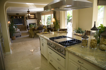 Kitchen and island with modern stove.