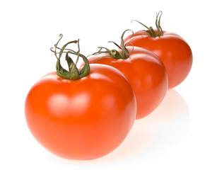 Three fresh tomatoes isolated