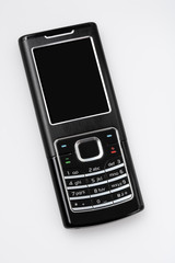 Modern GSM/UMTS phone on light grey background