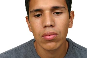 Young Hispanic Man Sad