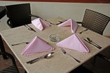 napkin and spoon on the dinning table poster